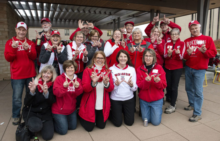 """Classmates from the Class of 1978 throwing up the Wisconsin """"W"""""""