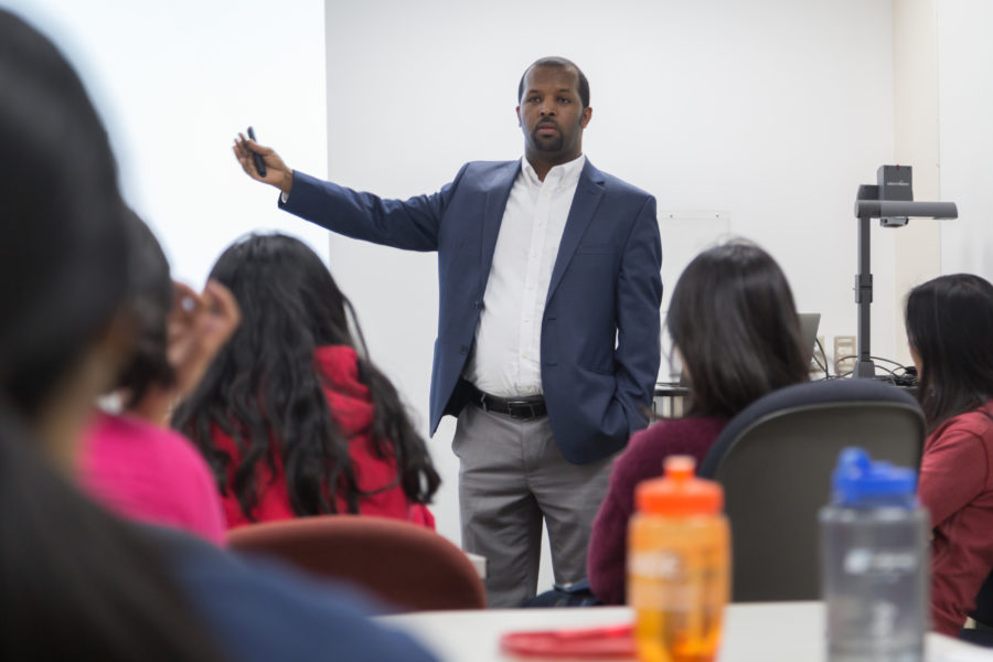 Ephrem Abebe speaking with students at the School of Pharmacy.
