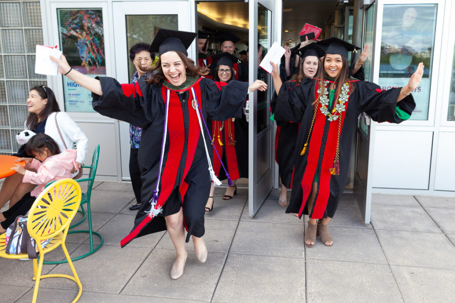 Students leaving the hooding ceremony in excitement.