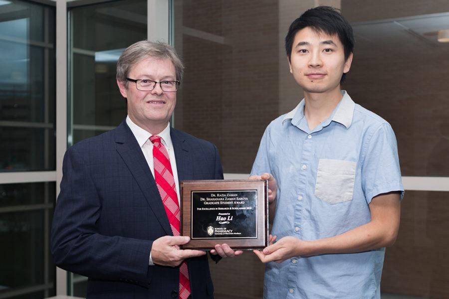 Chuck Lauhon giving a student an award